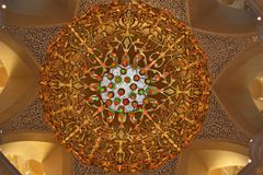 Golden coloured, gem studded chandlier, Sheikh Zayed Mosque, Bottom view Stock Photo