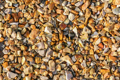 Golden coloured stone chippings. For background Royalty Free Stock Photo