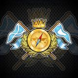 Golden compass with crown between wreath and flags on blackboard. Sport logo for any yachting or sailing team. Or championship royalty free illustration