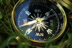Golden compass on grass Royalty Free Stock Photography