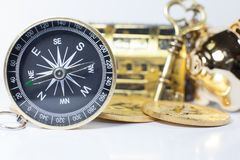 Golden Compass guiding business investment, stock, money trading in right direction to wealth, rich, success, fortune. Vision, Key. Positioning, Strategy, Plan stock image