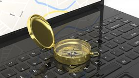 Golden compass on laptop Royalty Free Stock Photography
