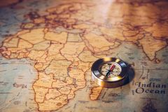 Golden Compass and the Map. Travel and Navigation Theme. Map use Royalty Free Stock Image