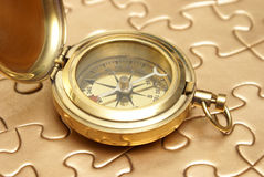 Golden Compass and Puzzle Concept Royalty Free Stock Image