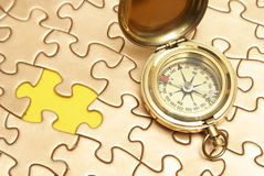 Golden Compass and Puzzle Concept Stock Photography