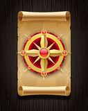 Golden compass rose & vintage scroll map Royalty Free Stock Photography