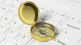 Golden compass on white laptop Royalty Free Stock Images