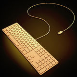 Golden computer keyboard on black background. Royalty Free Stock Photos