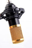 GOLDEN CONDENSER MICROPHONE. On isolated white background. Commonly used in studio recording Stock Photos