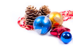 Golden cones with garland balls isolated on white Stock Images
