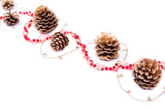Golden cones with garland isolated on white Royalty Free Stock Image