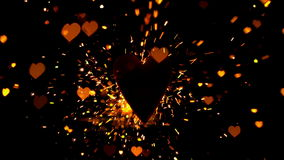 Golden confetti and sparks flying against heart Royalty Free Stock Photo