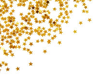 Golden confetti. In star shape isolated on white stock images