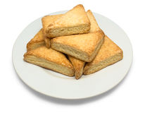 Golden cookie of the triangular form on plate Stock Photography