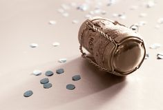 Golden cork and confetti Stock Photos