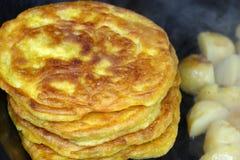 Golden corn cake with roast potatoes Royalty Free Stock Image