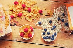 Golden corn flakes, Hercules oat and some berries in a cup on a Stock Images