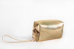 Golden cosmetic bag  Royalty Free Stock Image