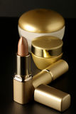 Golden cosmetics Stock Photography