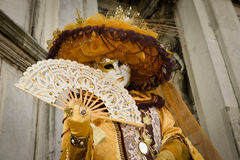 Golden costumed masked woman Royalty Free Stock Photography