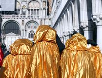 GOLDEN  costumes for the Carnival in Venice Royalty Free Stock Photo