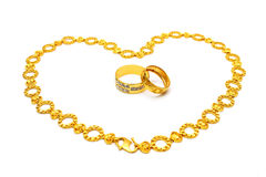 Golden Couple Ring and Necklace Royalty Free Stock Photos