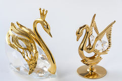Golden couple swans figurine. Beautiful golden couple swans figurine on white background Stock Photo