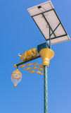 golden cow light bulb and solar energy with blue sky background Royalty Free Stock Images