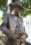 Golden cowboy with gun. Human sculpture, It is show on Frisco Annual Arts Walk , TX USA 2017 stock photos