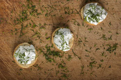 Golden crackers with cream cheese Stock Images