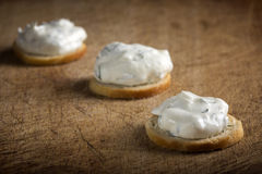 Golden crackers with cream cheese Royalty Free Stock Photo