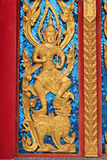 Golden Craved Angel in Thai Temple Windows Stock Photos