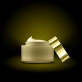 Golden cream container Royalty Free Stock Photo