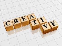 Golden creative. 3d golden cubes with text - creative, word Royalty Free Stock Photography