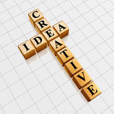 Golden creative idea like crossword. 3d golden cubes with black letters like crossword with text - creative idea Stock Images