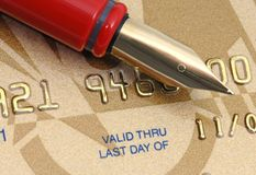 Golden credit card. International golden credit card and red pen Stock Photo