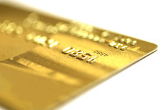 Golden credit card. Macro, very shallow DOF royalty free stock photo
