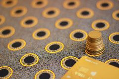 Credit card and stack of coins royalty free stock photography