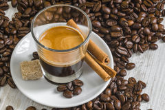 Golden crema on espresso coffee in transparent glass Royalty Free Stock Images