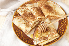 Golden crepes Royalty Free Stock Image