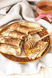 Golden crepes with  honey Royalty Free Stock Photography