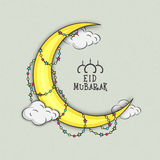 Golden crescent moon for Eid Mubarak festival celebration. Golden crescent moon on clouds, decorated with colorful stars on grungy background for holy festival Stock Photo