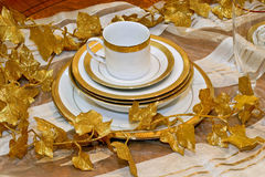 Golden crockery Royalty Free Stock Image