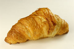 Golden Croissant. Fresh Golden Croissant on a white background royalty free stock photography