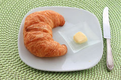 Golden croissant for breakfast Royalty Free Stock Photography