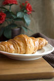 Golden croissant on dish Royalty Free Stock Photo