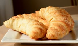 Golden Croissants On Plate. Royalty Free Stock Photos