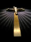 Golden cross. With rays of light over black royalty free stock photo