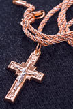Golden cross  on a black cloth Royalty Free Stock Photography
