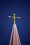 Golden Cross and Blue Sky. Golden cross, brightly lit, against deep blue sky Stock Photos